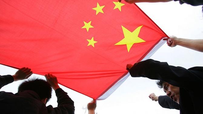 Парламентът на Хонконг прие днес закон, криминализиращ неуважението към националния