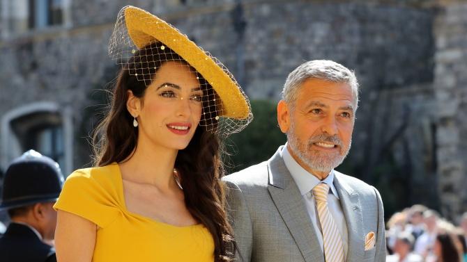 Американският актьор Джордж Клуни и съпругата му Амал Клуни, британски