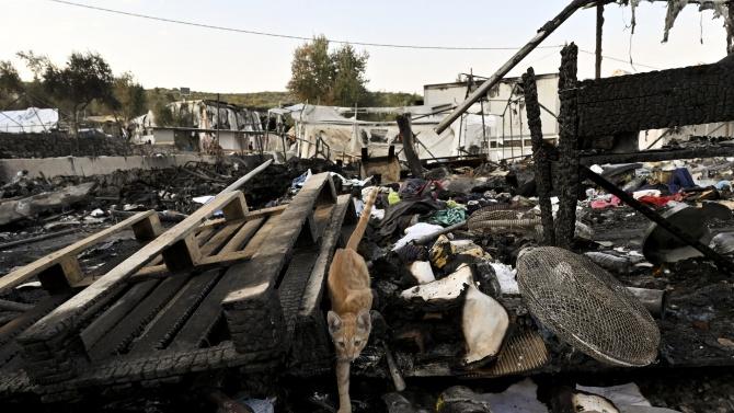 Четирима афганистански мигранти са обвинени за палежа в лагера Мория